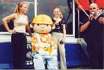 The girls from Suspicion strike a pose with Bob the Builder at Truckfest 2001 at the Bath and West Showground.