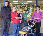 Helen of Nursery Rhymes and Tony Temple hand over the grand opening prize for the new store.
