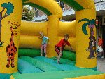 The kids enjoy the bouncy castle whilst listening to the YDR FM Roadshow.  The Liberal Club, Yeovil, 04-Aug-2001.