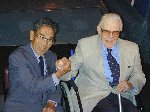 Kaname Harada and John Sykes showing that they are now friends, sixty years after their initial encounter - a dog fight in World War Two.  Fleet Air Arm Museum, Yeovilton, 07-Aug-2001