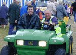 Tony Temple hitches a lift on the Big Green Machine driven by Gordon.  Yeovil Festival of Transport 2001, 11-Aug-2001.