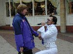 Elvis pounces on an unsuspecting passer by.  Children In Need - Quedam Yeovil, 16-Nov-2001